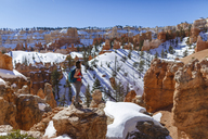 Side view of hiker standing on mountain against clear sky at Bryce Canyon National Park - CAVF22573