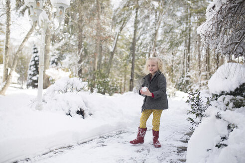 Girl playing with snow at park - CAVF22933