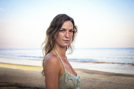 Portrait of beautiful woman at beach against sky - CAVF23272