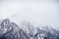 Scenic view of mountains during foggy weather - CAVF23470
