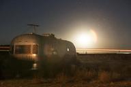 Motor home on field at night - CAVF23761