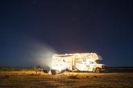 Camper van on field against sky during night - CAVF23764