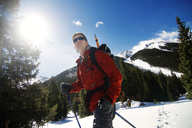 Low angle view of skier standing on snow field - CAVF23863