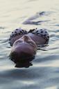 Close-up of seductive woman in lake - CAVF24040