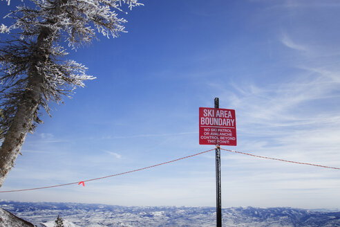 Low angle view of warning sign against sky during winter - CAVF24100
