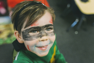 High angle view of cute boy with face paint during Halloween - CAVF24719