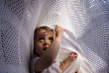 Sunlight emitting through fabric on cute boy - CAVF24728