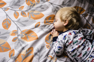 High angle view of boy sleeping on bed - CAVF24731