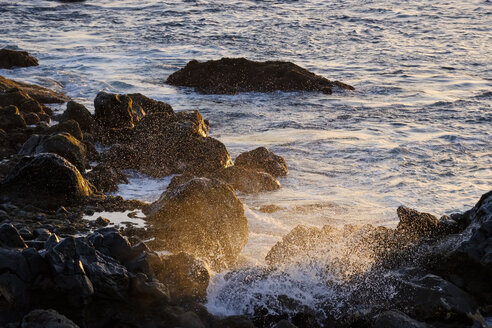 Spain, Canary Islands, La Gomera, surf at sunset - SIEF07750