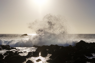 Spain, Canary Islands, La Gomera, Valle Gran Rey, La Puntilla, surf at sunset - SIEF07753
