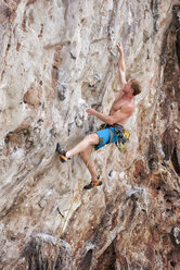 Thailand, Krabi, Lao Liang, barechested climber in rock wall - ALRF01016