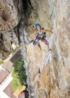 Thailand, Krabi, Tonsai beach, woman climbing in rock wall - ALRF01031