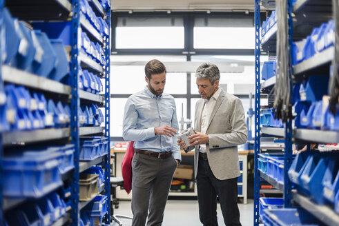 Businessmen during meeting in storage - DIGF03507