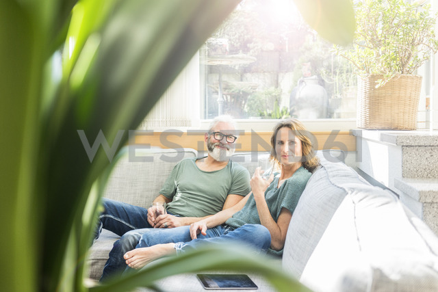 Mature couple relaxing on couch at home - MOEF00964