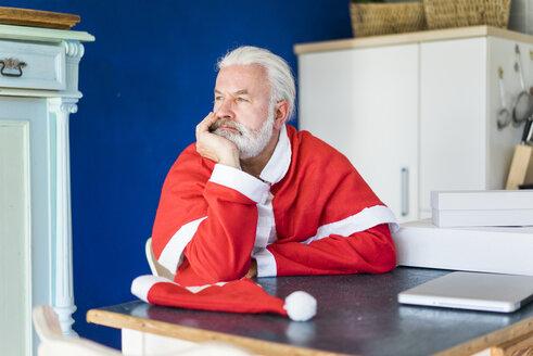 Bearded mature man wearing Santa costume looking sdeways - MOEF00994