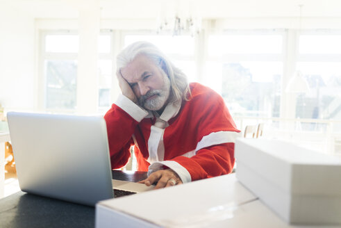 Frustrated Santa using laptop at home - MOEF01003