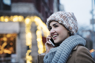 Close-up of happy woman talking on mobile phone - CAVF25650