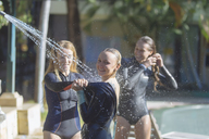 Indonesia, Bali, female surfers showering - KNTF01099