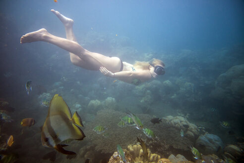Full length of woman swimming in sea - CAVF26780