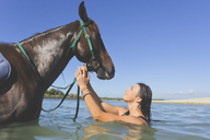 Indonesia, Bali, Woman with horse - KNTF01108