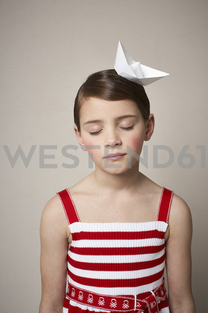 Portrait of little girl with paper boat on her head - FSF01005