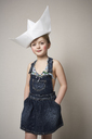 Portrait of fashionable little girl with big paper boat on her head - FSF01008