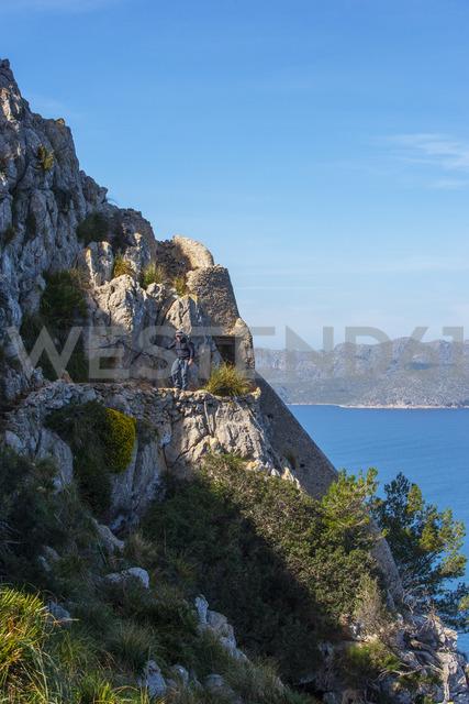Spain, Balearic Islands, Mallorca, Peninsula Alcudia, hiker on hiking trail to Penya del Migdia - WWF04217