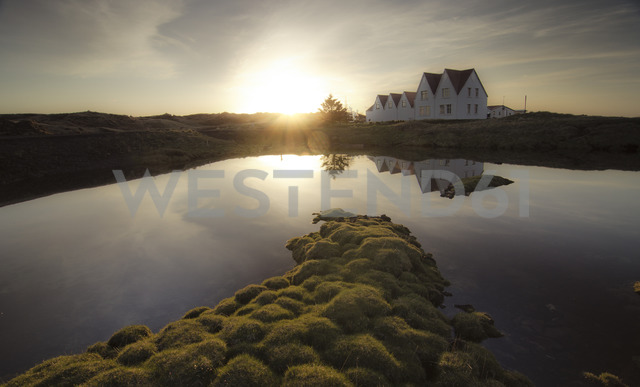 Iceland, Straumur, row houses at sunset - STCF00550