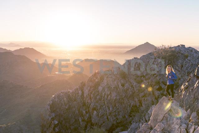 Hiker standing at Piestewa Peak against clear sky during sunrise - CAVF27378 - Cavan Images/Westend61