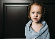 Portrait of boy wrapped in towel at home - CAVF27504