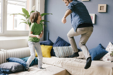 Playful father and son at home - KNSF03623