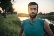 Portrait of confident sportsman standing at park - CAVF27764
