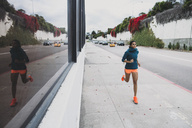 Young woman jogging on footpath - CAVF27941