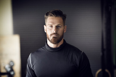 Portrait of confident male athlete in gym - CAVF28166