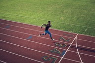 High angle view of male athlete running on field - CAVF28274