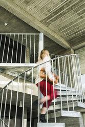 Businesswoman rushing upstairs - UUF13124
