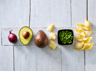 Ingredients of pasta with avocado sauce, peas and parmesan - KSWF01845