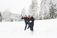 Young couple having snowball fight - FOLF00128