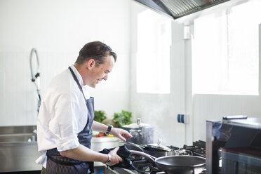 Cook preparing food in kitchen - KVF00133