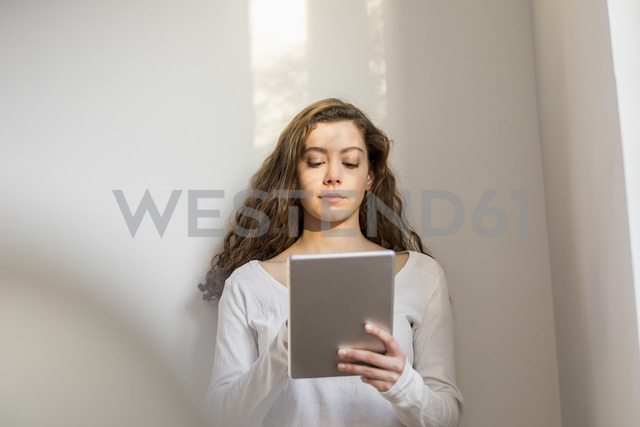 Teenage girl using digital tablet - FMKF04979