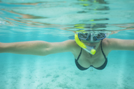 Portrait of woman snorkeling under water - ZEF15239