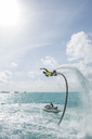 Maldives, man on flyboard above the sea - ZEF15251