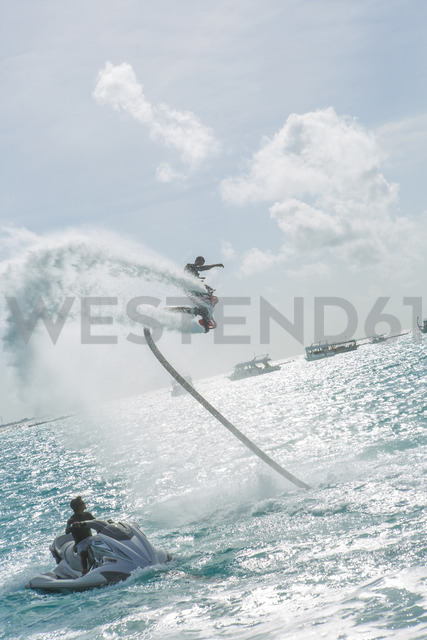Maldives, man on flyboard above the sea - ZEF15254