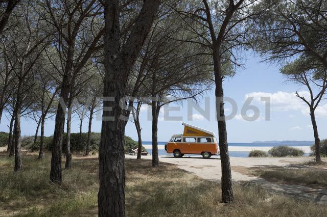Italy, Sardinia, Posada, man on vacation with an old van - CRF02773
