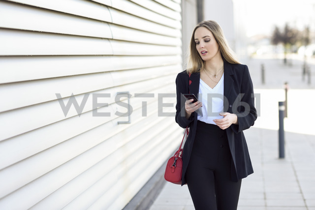 Portrait of businesswoman using cell phone - JSMF00127