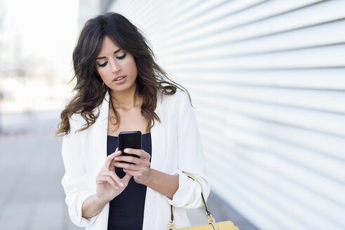 Portrait of businesswoman using cell phone - JSMF00133