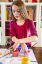 Girl playing with finger paint - SARF03620