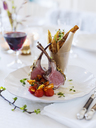 Lamb chops and french fries on table - FOLF00334