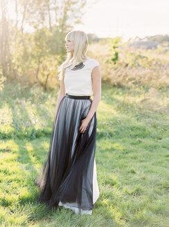 Full length portrait of bride standing in grass - FOLF00463