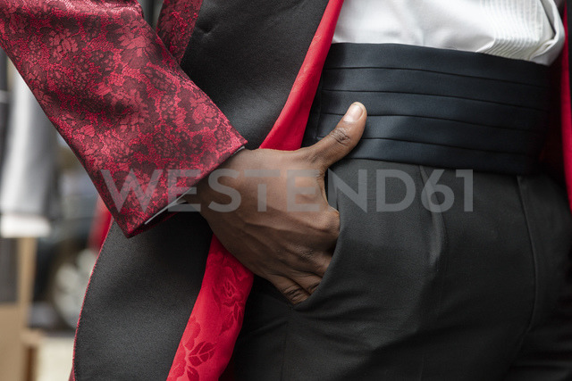 Detail of a man wearing tuxedo in tailor shop with hand in the pocket - LFEF00104
